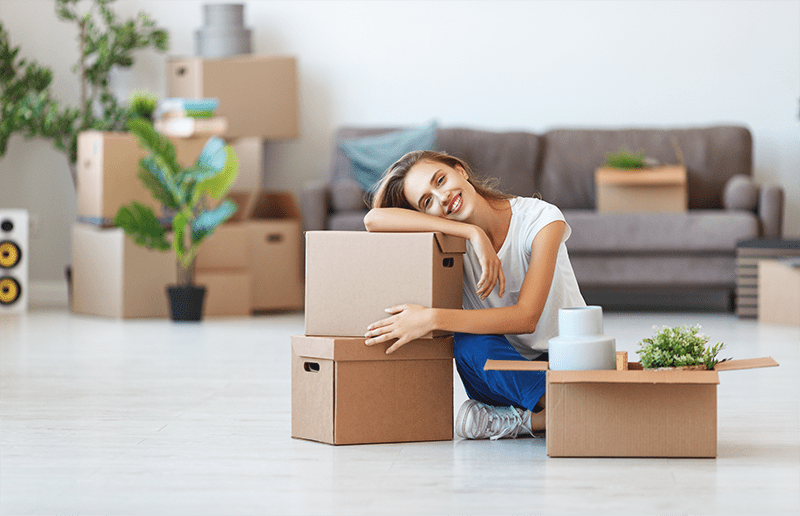 lady packing moving boxes